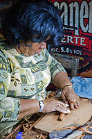 Cuba, Havana.  Partagas Cigar Factory.  Woman Cigar Maker (Torcedor).