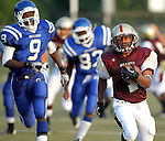 Waterbury, CT-07 September 2012-090712CM05- Sacred Heart's Shyquon Thompson carries the ball against Crosby in the first quarter during the City Jamboree Friday night at Municipal Stadium in Waterbury.  Sacred Heart won the quarter.     Christopher Massa Republican-American