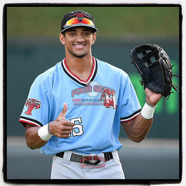 Bubba Thompson (25) of the Hickory Crawdads gives in after noticing I was taking his photo before a game against the Greenville Drive on Monday, August 20, 2018, at Fluor Field at the West End in Greenville, South Carolina. Hickory won, 11-2. (Tom Priddy/Four Seam Images) #milb #minorleagues #minorleaguebaseball #baseball #sallyleague #rangers
