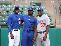 Three native Cubans (Jorge Soler of the AZL Cubs and Onelki Garcia and Yasiel Puig of the AZL Dodgers) meet before a game at Hohokam Stadium on August 8, 2012 in Mesa, Arizona (Bill Mitchell)