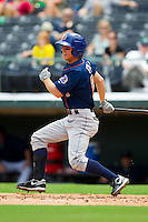 Evan Frey (21) of the Durham Bulls follows through on his swing against the Charlotte Knights at Knights Stadium on August 18, 2013 in Fort Mill, South Carolina.  The Bulls defeated the Knights 8-5 in Game One of a double-header.  (Brian Westerholt/Four Seam Images)
