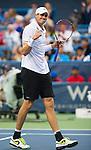 John Isner (USA) Defeats Dmitry Tursunov (RUS) 6-7(7), 6-3, 6-4