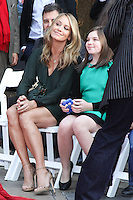 HOLLYWOOD, CA - DECEMBER 03: Christine Taylor, Ella Stiller attending the Ben Stiller Hand/Footprint Ceremony held at TCL Chinese Theatre on December 3, 2013 in Hollywood, California. (Photo by David Acosta/Celebrity Monitor)