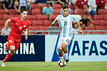 Paulo Dybala of Argentina (R) in action against Daniel Bannett of Singapore (L) during the International Test match between Argentina and Singapore at National Stadium on June 13, 2017 in Singapore. Photo by Marcio Rodrigo Machado / Power Sport Images