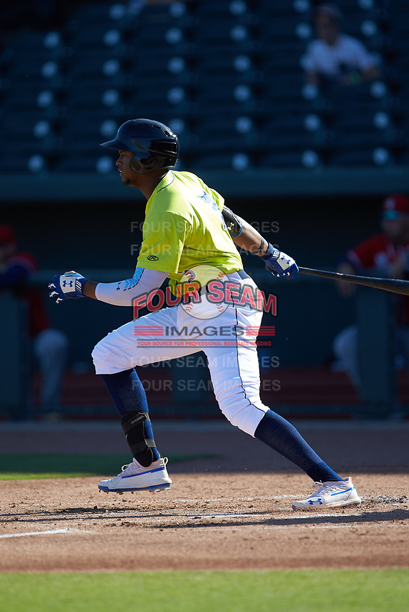 Shervyen Newton (3) of the Columbia Fireflies follows through on his swing against the Rome Braves at Segra Park on May 13, 2019 in Columbia, South Carolina. The Fireflies walked-off the Braves 2-1 in game one of a doubleheader. (Brian Westerholt/Four Seam Images)
