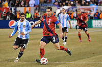 Carlos Bocanegra (3) of the United States is chased by Ever Banega (20) of Argentina. The United States (USA) and Argentina (ARG) played to a 1-1 tie during an international friendly at the New Meadowlands Stadium in East Rutherford, NJ, on March 26, 2011.