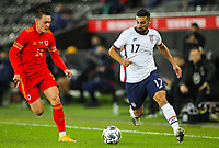 12th November 2020; Liberty Stadium, Swansea, Glamorgan, Wales; International Football Friendly; Wales versus United States of America; Sebastian Lletget of USA brings the ball forward while under pressure from Connor Roberts of Wales