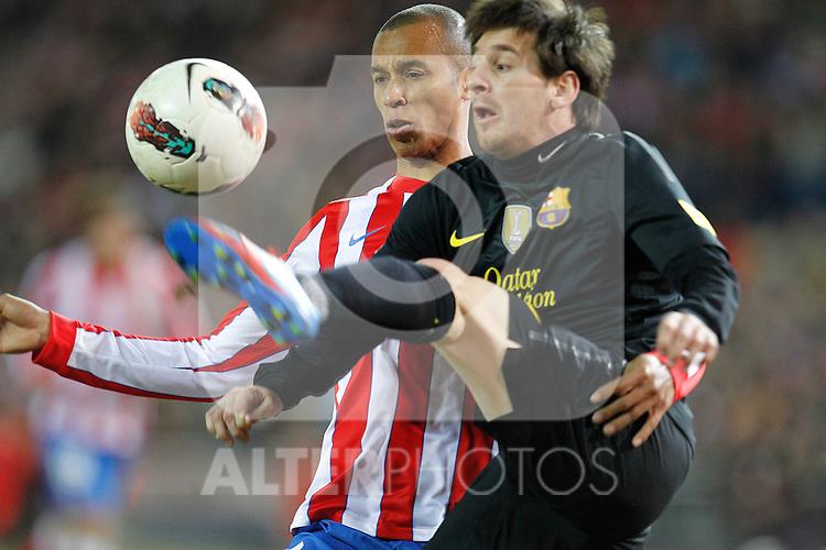 Atletico de Madrid's Joao Miranda and F.C. Barcelona's Lionel Messi during la Liga match on february 26th, 2012. ..Photo: Cesar Cebolla / ALFAQUI