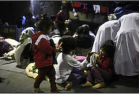 Pictured: Barefoot children play in a disused warehouse Monday 07 March 2016<br /> Re: Migrants have been gathering at the port of Piraeus, near Athens, Greece.