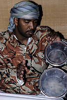 Oman.  Afro-Arab Omani Playing the Drums.