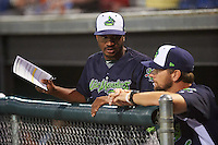 Vermont Lake Monsters hitting coach Lloyd Turner (11) talks with manager Aaron Nieckula (26) in the dugout during a game against the Auburn Doubledays on July 12, 2016 at Falcon Park in Auburn, New York.  Auburn defeated Vermont 3-1.  (Mike Janes/Four Seam Images)