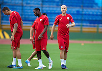 (Left to right) Geoff Cameron, Maurice Edu, Michael Bradley go through some warm-up routines at Estadio Mateo Flores in Guatemala City, Guatemala on Mon. June 11, 2012.  The USA will face Guatemala in a World Cup Qualifier on Tuesday.