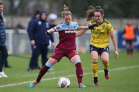 Katharina Baunach of West Ham and Lisa Evans of Arsenal during West Ham United Women vs Arsenal Women, Women's FA Cup Football at Rush Green Stadium on 26th January 2020