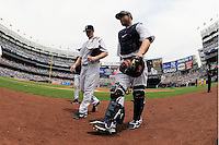 New York Yankees pitcher Brian Gordan #22 and catcher Russell Martin #55 walk in from the bullpen prior to game against the Texas Rangers at Yankee Stadium on June 16, 2011 in Bronx, NY.  Yankees defeated Rangers 3-2.  Tomasso DeRosa/Four Seam Images