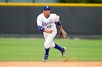Burlington Royals shortstop Ramon Torres (25) charges a ground ball against the Greeneville Astros at Burlington Athletic Park on July 1, 2013 in Burlington, North Carolina.  The Astros defeated the Royals 7-0 in Game One of a doubleheader.  (Brian Westerholt/Four Seam Images)