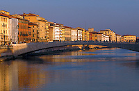 View of the Arno River with houses and bridge, Pisa, Italy