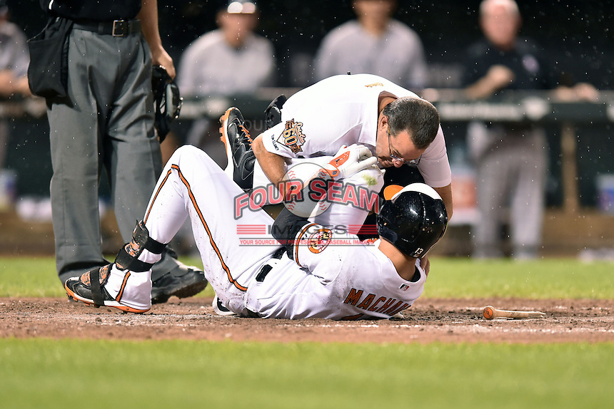 Baltimore Orioles third baseman Manny Machado #13 after twisting his knee during a game against the New York Yankees at Oriole Park at Camden Yards August 11, 2014 in Baltimore, Maryland. The Orioles defeated the Yankees 11-3. (Tony Farlow/Four Seam Images)