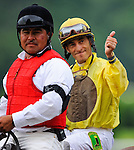 John Velazquez gives a thumbs up to the crowd after winning the 144th running of the Belmont Stakes aboard Union Rags in Elmont, New York on June 9, 2012.