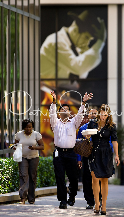 Business professionals walk in uptown Charlotte, NC.