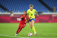 YOKOHAMA, JAPAN - AUGUST 6: Jayde Riviere #8 of Canada and Lina Hurtig #8 of Sweden battle for the ball during a game between Canada and Sweden at International Stadium Yokohama on August 6, 2021 in Yokohama, Japan.
