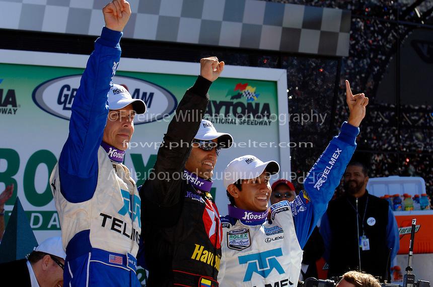 Race winners Scott Pruett, Juan Pablo Montoya and Salvador Duran celebrate in Victory Lane.