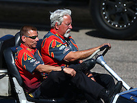 Feb 28, 2016; Chandler, AZ, USA; NHRA funny car driver Jim Campbell (left) with team owner Chuck Worsham during the Carquest Nationals at Wild Horse Pass Motorsports Park. Mandatory Credit: Mark J. Rebilas-