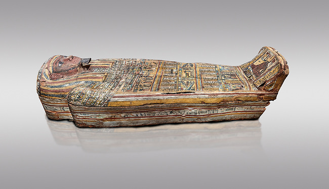 Ancient Egyptian wooden sarcophagus - the tomb of Tagiaset, Iuefdi, Harwa circa 7th cent BC - Thebes Necropolis. Egyptian Museum, Turin. Grey background
