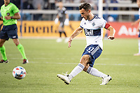 SAN JOSE, CA - AUGUST 13: Russell Teibert #31 of the Vancouver Whitecaps passes the ball during a game between San Jose Earthquakes and Vancouver Whitecaps at PayPal Park on August 13, 2021 in San Jose, California.