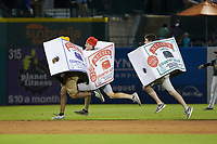 The Neese's Sausage race takes place between innings of the South Atlantic League game between the West Virginia Power and the Greensboro Grasshoppers at First National Bank Field on June 1, 2018 in Greensboro, North Carolina. The Grasshoppers defeated the Power 10-3. (Brian Westerholt/Four Seam Images)