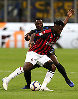 Calcio, Serie A: Inter Milano - AC Milan , Giuseppe Meazza stadium, .October 21, 2018.<br /> Milan's Franck Kessie (in front of) in action with Inter's Kwadwo Asamoah (behind) during the Italian Serie A football match between Inter and Milan at Giuseppe Meazza (San Siro) stadium, October 21, 2018.<br /> UPDATE IMAGES PRESS/Isabella Bonotto