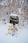 Pemi Trail sign covered in snow in Franconia Notch State Park of New Hampshire White Mountains.