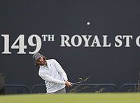 12th July 2021; The Royal St. George's Golf Club, Sandwich, Kent, England; The 149th Open Golf Championship, practice day; Tommy Fleetwood (ENG) plays a pitch shot to the 18th green