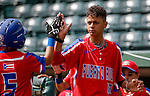 ABERDEEN, MD - AUGUST 02: Derek Gipson #5 of Puerto Rico is congratulated by Peter Vazquez #12 of Puerto Rico after scoring a run in the 1st inning during a game between the Dominican Republic and Puerto Rico during the Cal Ripken World Series at The Ripken Experience Powered by Under Armour on August 2, 2016 in Aberdeen, Maryland. (Photo by Ripken Baseball/Eclipse Sportswire/Getty Images)