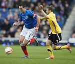 Rangers captain Lee Wallace gets past Montrose's Martin Boyle