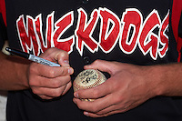 Batavia Muckdogs players sign autographs for youth camp participants before a game against the Lowell Spinners on August 12, 2015 at Dwyer Stadium in Batavia, New York.  Batavia defeated Lowell 6-4.  (Mike Janes/Four Seam Images)
