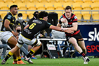 Josh McKay of Canterbury is tackled by Caleb Delany of Wellington during the Bunnings NPC - Wellington v Canterbury at Sky Stadium, Wellington, New Zealand on Friday 8 October 2021.<br /> Photo by Masanori Udagawa. <br /> www.photowellington.photoshelter.comto