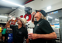 Nov 1, 2020; Las Vegas, Nevada, USA; NHRA top fuel driver Steve Torrence (left) celebrates with crew chief Richard Hogan after winning the 2020 top fuel World Championship at the NHRA Finals at The Strip at Las Vegas Motor Speedway. Mandatory Credit: Mark J. Rebilas-USA TODAY Sports