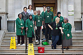 Cleaners on an early morning shift at Islington Town Hall with Catherine West, Leader of the Council (second row, left). The 130 cleaners of the borough's 70 municipal buildings are now directly employed by the local authority, following the ending of a 10 year contract with private company Kier Building Maintenance.