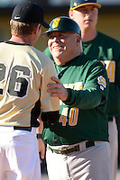 Siena Saints head coach Tony Rossi (40) shakes hands with Terry Rooney (26) after a game against the Central Florida Knights at Jay Bergman Field on February 16, 2014 in Orlando, Florida.  UCF defeated Siena 9-6.  (Mike Janes/Four Seam Images)
