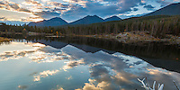 Taken looking east from Sprague Lake in Rocky Mountain National Park, CO.  These vivid reflections and backlighting lasted only a few moments as sunrise comes quickly at 8,200'.