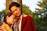 An Native American Lakota Sioux Indian mother hugging her son