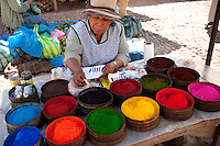 In the Town of Maras , a Lady sells traditional Andean dyes at the market. These natural, Peruvian dyes are used not only to enhance and embellish the color of an object or clothing, but are indicators of hierarchy and status. The process of searching for and extracting the dye is a rigorous activity.