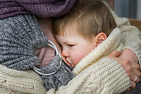 Close-up of a mother breastfeeding her 15 month old boy who is in a sling.<br /> <br /> London, England, UK<br /> 22-03-2015<br /> <br /> © Paul Carter / wdiip.co.uk