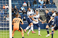 KANSAS CITY, KS - MAY 16: Lucas Cavallini #9 Vancouver Whitecaps heads on goal during a game between Vancouver Whitecaps and Sporting Kansas City at Children's Mercy Park on May 16, 2021 in Kansas City, Kansas.