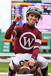 NEW ORLEANS, LA - MARCH 26: Florent Geroux shows the #1 sign after winning the 103rd Louisiana Derby while riding Gun Runner #1 at Fairgrounds Race Course on March 26, 2016 in New Orleans, Louisiana. (Photo by Steve Dalmado/Eclipse Sportswire/Getty Images)