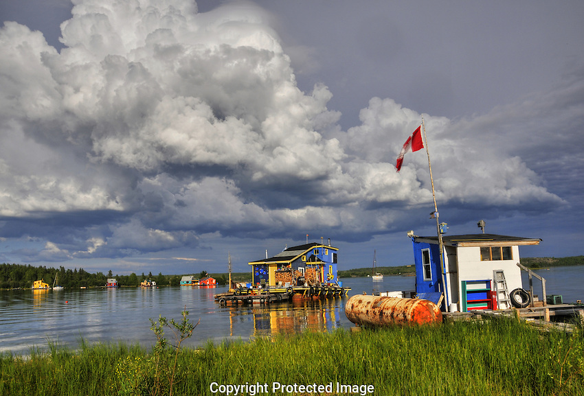 Unsettled summer weather over the houseboats of Yellowknife Bay