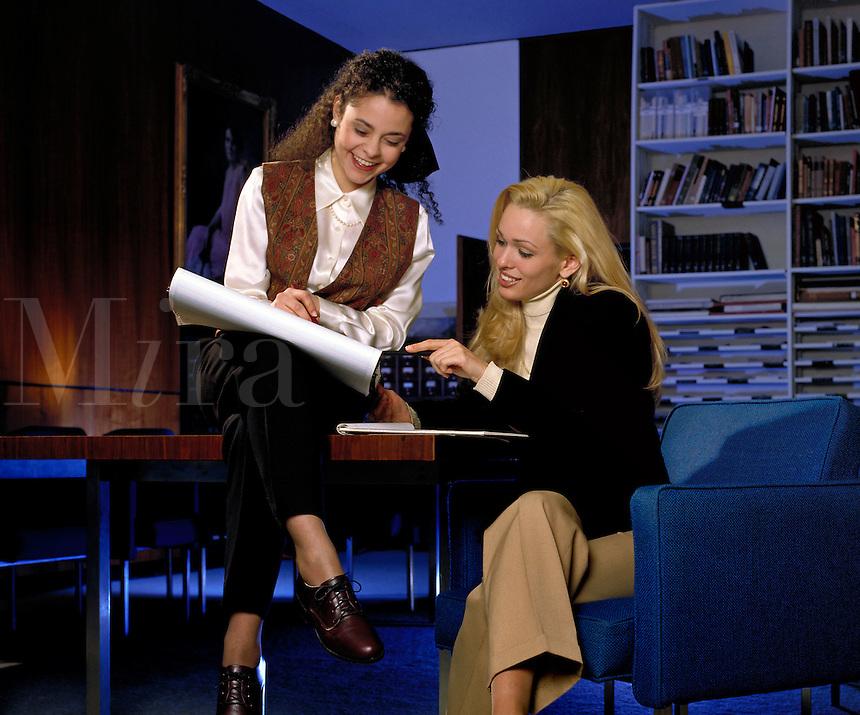 Young women share business plan at Art center office.  Little Rock, Arkansas.