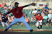 Kannapolis Intimidators first baseman Corey Zangari (25) on defense as Greg Cullen (18) of the Rome Braves takes his lead while starting pitcher Johan Dominguez (31) delivers a pitch to the plate at Kannapolis Intimidators Stadium on July 3, 2019 in Kannapolis, North Carolina.  The Braves defeated the Intimidators 13-11, (Brian Westerholt/Four Seam Images)