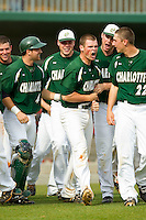 Brett Lang (6) of the Charlotte 49ers is surrounded by his teammates after hitting a walk-off solo home run in the bottom of the 9th inning against the Virginia Commonwealth Rams at Robert and Mariam Hayes Stadium on March 30, 2013 in Charlotte, North Carolina.  The 49ers defeated the Rams 9-8 in game one of a double-header.  (Brian Westerholt/Four Seam Images)