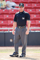 Base umpire Bryan Fields prior to the start of the South Atlantic League game between the Greensboro Grasshoppers and the Hickory Crawdads at  L.P. Frans Stadium July 10, 2010, in Hickory, North Carolina.  Photo by Brian Westerholt / Four Seam Images